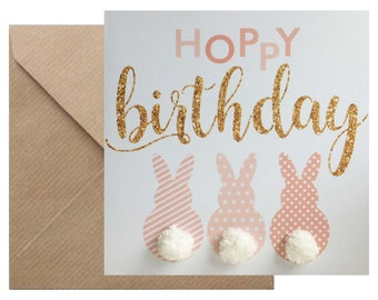 Cute rabbit 'Hoppy birthday' card, hand finished with three pompom 'tails'