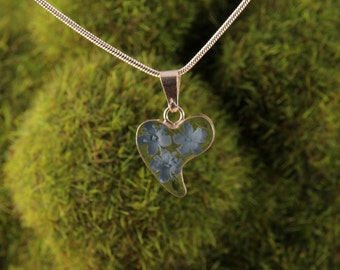 Sterling Silver Mianiature Pressed Blue Flowers Clear Heart Pendant