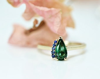 MADISON 0.70 ct. Green Tourmaline &  Blue Sapphire cluster ring on 14K yellow gold
