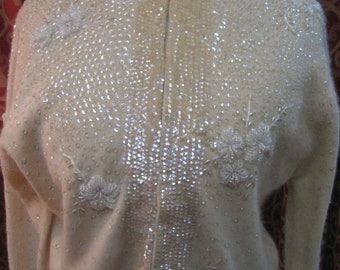 """1960's, 32"""" bust, cream colored cardigan sweater with sequins"""