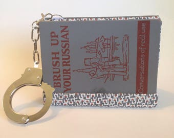 Collusion Clutch 100% to Charity Hispanic Federation book purse