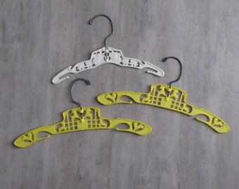 Vintage White / Yellow Plastic Children's Hangers - set of three