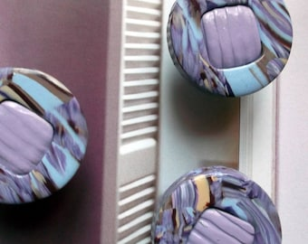 Button drawers or closets round, purple, beige, light blue and brown tones