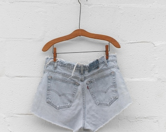 32 waist | Perfectly Distressed High Waist Levi's Denim Cut Offs