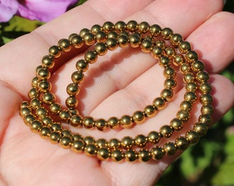 10 beads hematite color 4 MM round gold.