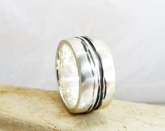 River ring in ecosilver 10mm wide mans wedding style ring.