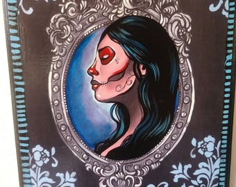 Day of the dead mounted print on wood. Hand embellished with acrylic paint. 9x12 hand painted details