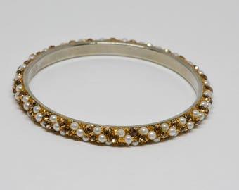 Charming Gold Tome Bangle Bracelet