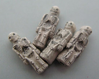 4 Small Skeleton Beads - white