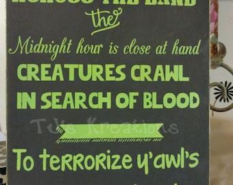 Glow in the dark -Darkness Falls across the land midnight thriller sign. halloween