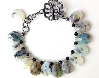 Peruvian blue opal bead bracelet with oxidised silver clasp.