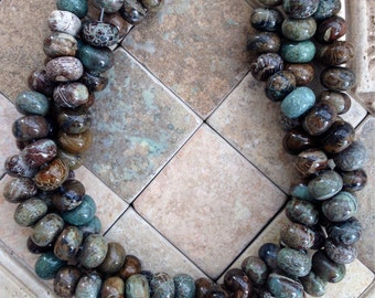 Reduced rondelle snakesin jasper beads