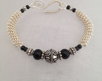 Silver wirework bracelet, with detailed metal focal bead