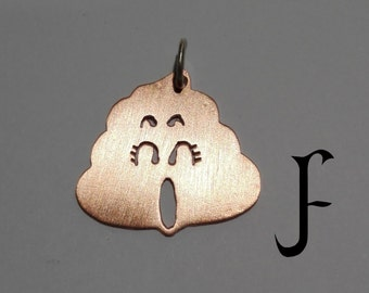 Arale poop pendant from Dr. Slump (copper - totally handmade)