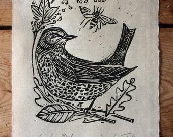 Lino cut print. Garden Bird design by Lou Tonkin