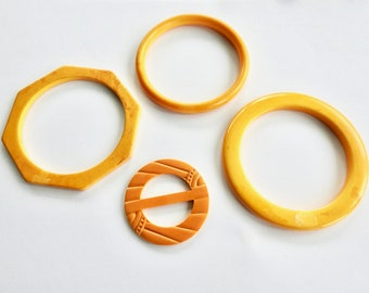 Three Butter scotch Bakelite Bangles and Carved Buckle