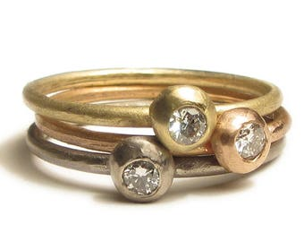Diamaond solitaire stacking rings in solid 18ct 18K gold
