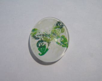 Glass cabochon oval 25 X 18 mm with a butterfly image green