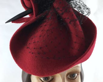Free-formed red felt perching hat with vintage black silk veiling and black Bakelite hat pin