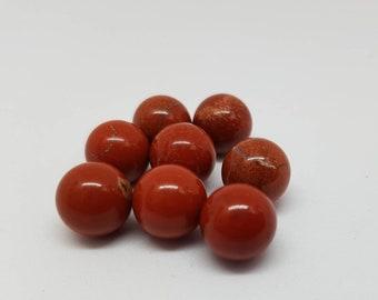 Red jasper stone marbles.