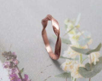 Narrow twisted copper ring, handmade