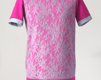 A pink t-shirt with grey lace overlay