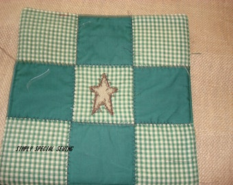Primitive Potholders with Embroidered Prim Star