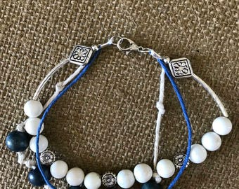 Blue, white and silver multi strand.  8 1/2""