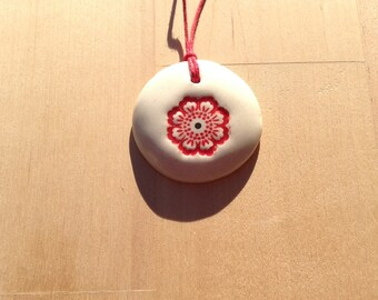 Necklace made of white ceramic and red glaze