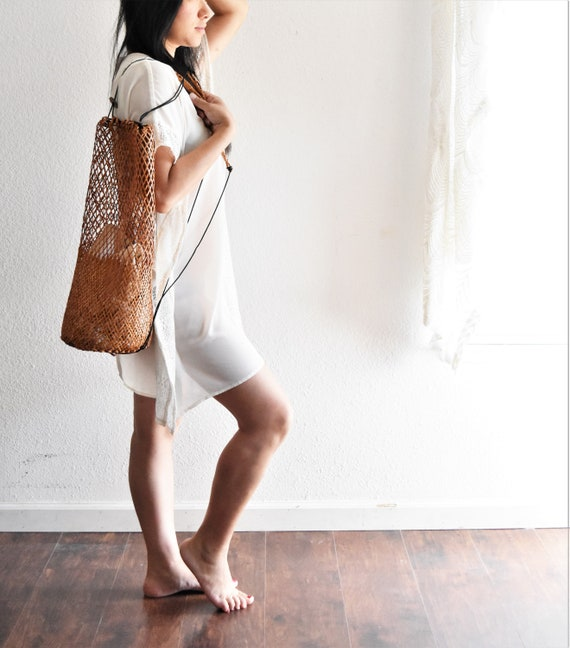 large woven rattan bamboo traveling drawstring backpack / tote purse