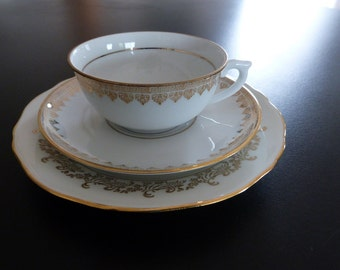 Romantic French Porcelain Trio in white and gold. French porcelain trio.