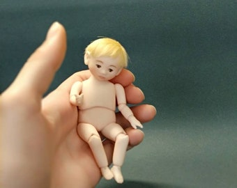 Author's, collectible, porcelain doll by Ketrin Guv. Miniature 1/12