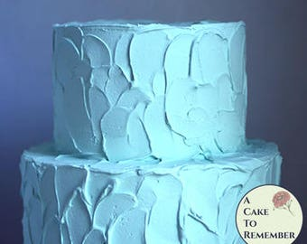 "Two tiered pale teal fake cake with swirly rustic icing, 6"" and 8"" tiers. Faux wedding cake for dessert buffet decoration or party decor"