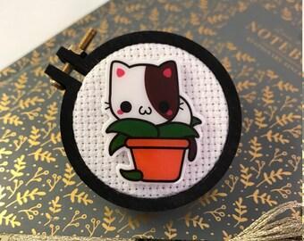Cat in Plant Needleminder