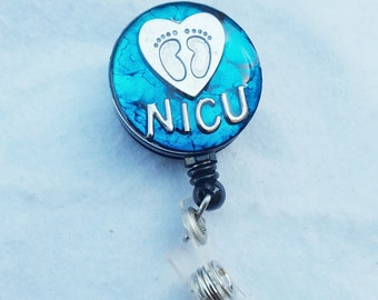 NICU name badge holder with a teal background, heart and footprint detail