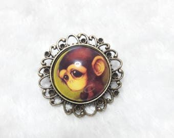 Round brooch monkey with big eyes