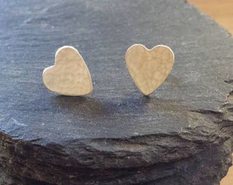Silver heart stud earrings, contemporary, 925 sterling silver, hammered, brushed finish.