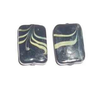 The Lot(Prize) of 2 rectangular black pearls filigrannées yellow 23x12mm