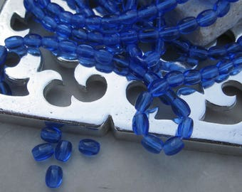 Vintage 5mm Oval Glass Beads in Sapphire.  3 dz.
