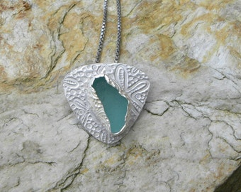 genuine aqua sea glass sterling silver pendant with patterned bezel