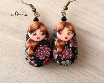 Earrings in the shape of matryoshka (nesting doll) decor inspired by a traditional Russian pattern