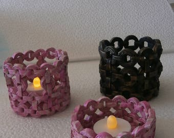 Lanterns with candles in recycled paper stack