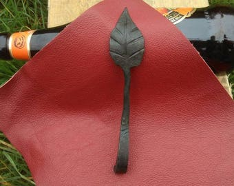 Hand forged leaf bottle opener. Made in England