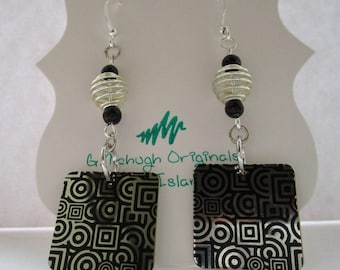 Groovy, swirly, geometric dangly earrings with silver accents