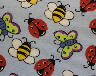 """Ladybugs Bees Butterflies on blue 100% cotton flannel  41""""-44"""" wide"""