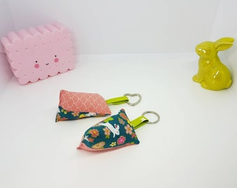 Key choice, gift-wrapped in fabric, cotton bag charm keychain. Pink salmon and green Christmas tree, cotton Japanese flowers and rabbits.