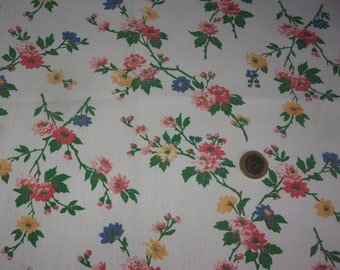 An antique fabric branches of flowers on an ecru background