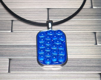 Rectangular Pendant with Glass Spheres on Blue Necklace