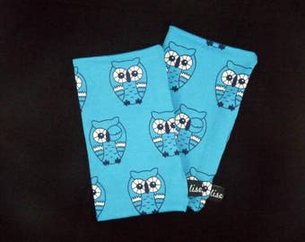Cuddly handsewn wrist warmer with owl pattern in turquoise