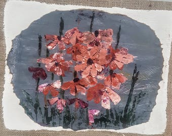 Palette knife flowers on gessoed brown paper attached to burlap canvas.
